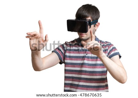 Man is wearing 3D virtual reality headset and is touching something. Isolated on white background.