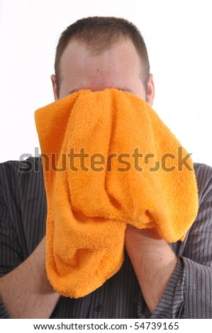 Man is wiping his face with an orange towel