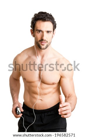 Man jogging and listening to music on his mp3 player, isolated - stock photo