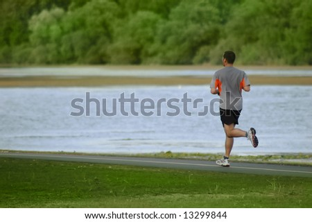 Man jogging by the lake