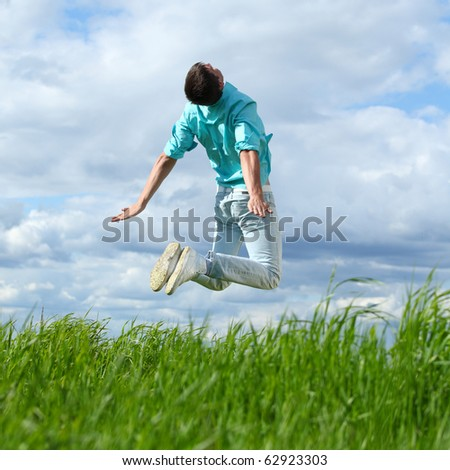 man jump in the blue sky - stock photo