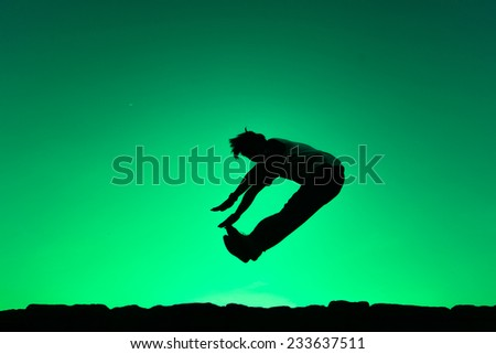 Man jump on green background. Element of design. - stock photo