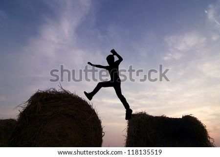 Man jump through the gap. - stock photo