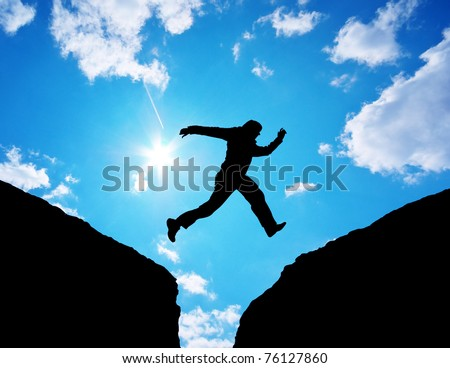 Man jump through the gap. Element of design. - stock photo