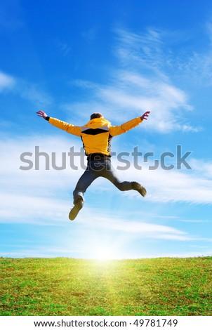 Man jump to sun. Emotional scene. - stock photo
