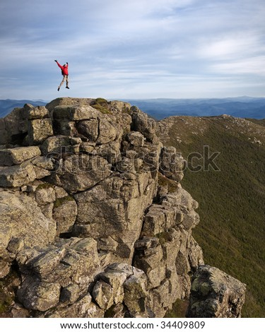 Man jumping at the top - stock photo