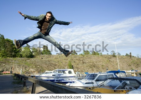 Man jumping by the sea - stock photo
