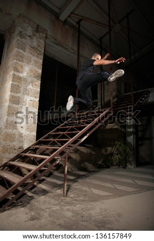 man jumping from stairs very  high - stock photo