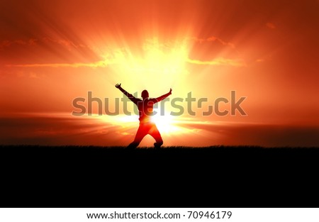 Man Jumping in Sun Rays - stock photo