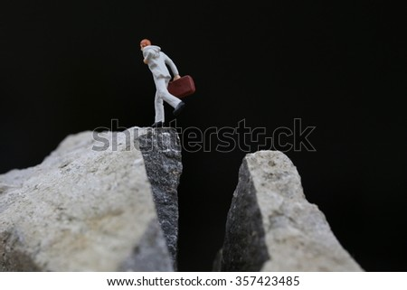 Man jumping off a cliff