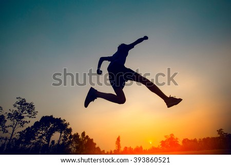 man jumping sunset background