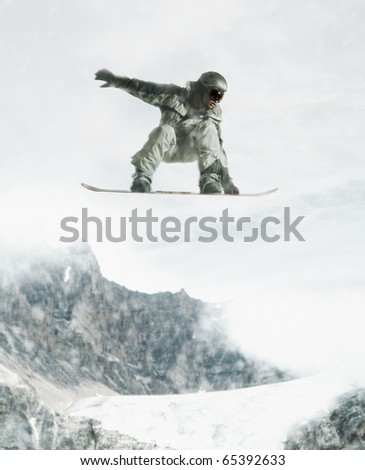 Man jumping with snowboard - stock photo