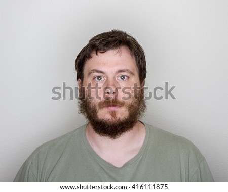 Man just has a blank stare while looking at the camera