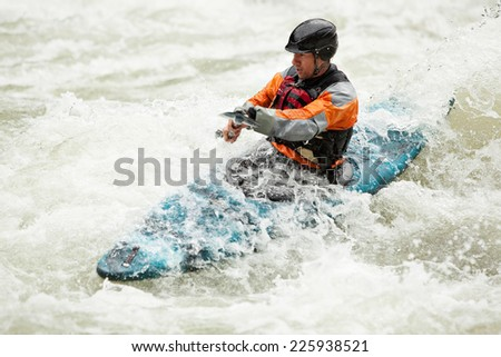 Man kayaking down a section of whitewater on the Skykomish River in Washington State.  - stock photo