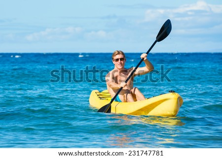 Man Kayaking in the Tropical Ocean in Yellow Kayak on Sunny Morning in Hawaii - stock photo