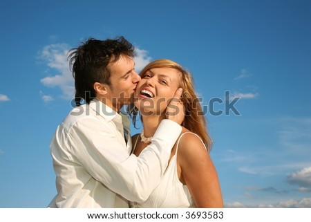 man kisses the woman