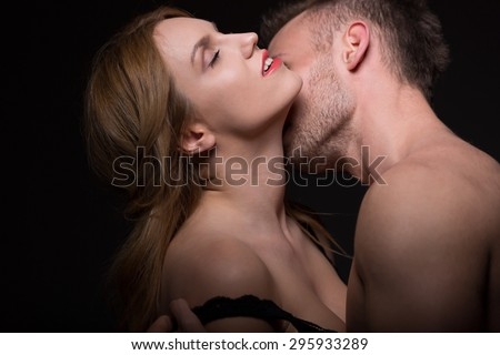 Man kissing passionately his woman's neck