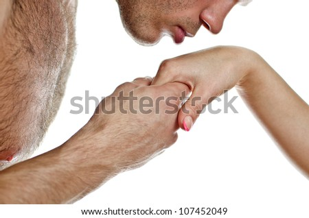 Man kissing woman's hand. Isolated on white. - stock photo