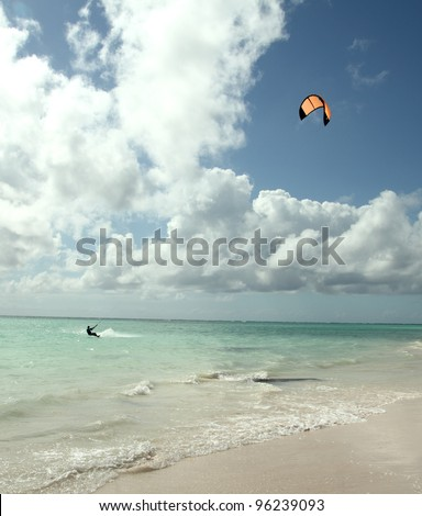 man kite surfing near the beach - stock photo