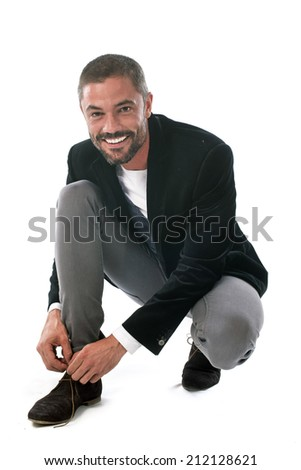 man lace up in front of white background