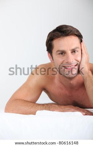 Man laid on massage table - stock photo