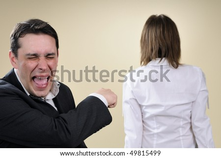 man laughing and upset colleague - stock photo