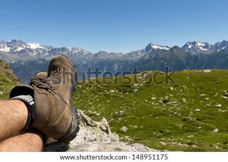 Man laying after mountain hiking - stock photo