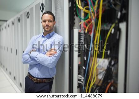 Man leaning against server locker in data center - stock photo
