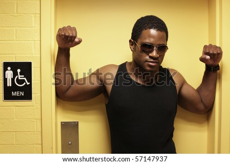 Man leaning in Mens Restroom Doorway - stock photo
