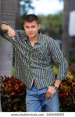 Man leaning on a tree - stock photo