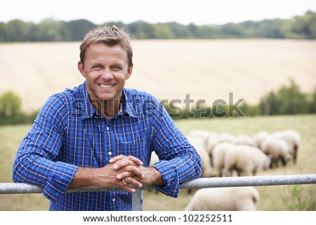 Man leaning on country fence - stock photo