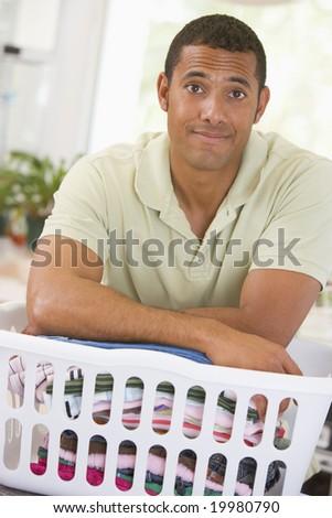 Man Leaning On Laundry - stock photo