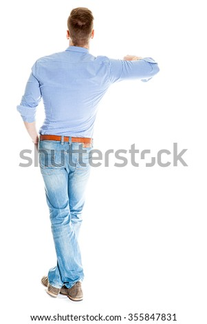 Man leaning on something imaginary - isolated over a white background - stock photo