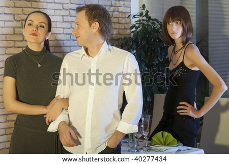 man leaving his girlfriend with another woman - stock photo
