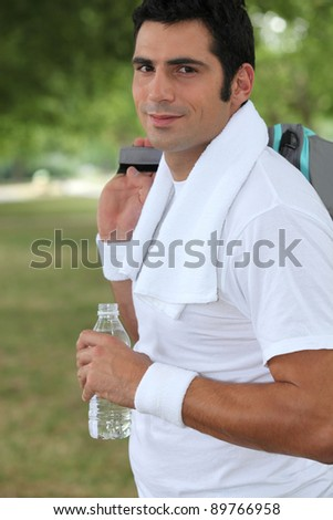 Man leaving the gym - stock photo