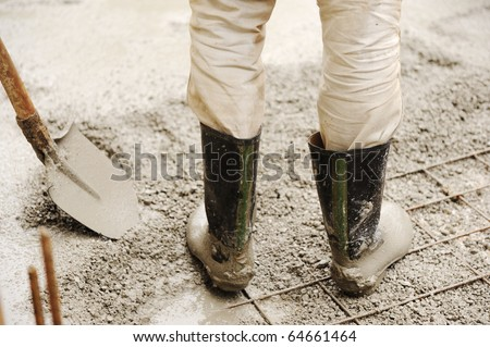 Man leveling concrete slab, working place - stock photo