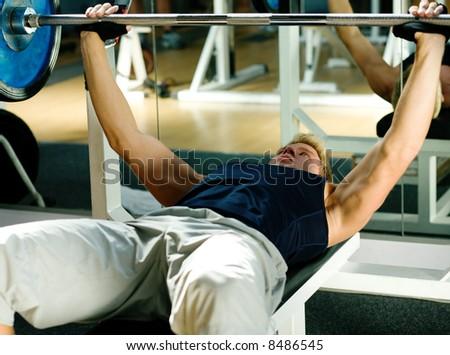 Man lifting a barbell - stock photo