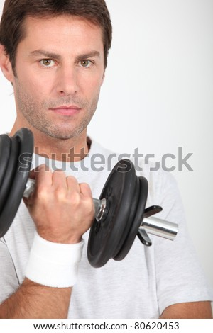Man lifting a dumbbell - stock photo