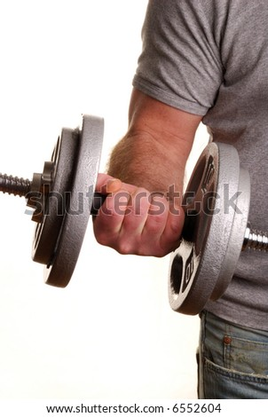 Man lifting dumbell weights - stock photo