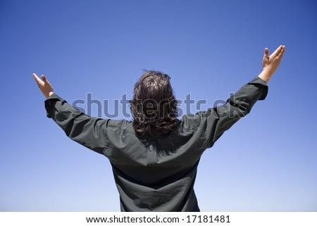 man lifting hands - stock photo