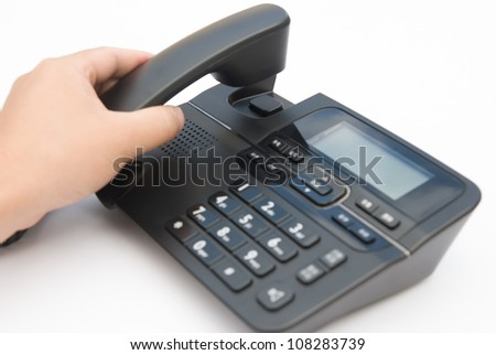 man lifting up a telephone receiver - stock photo