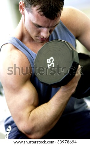 man lifting weights - stock photo