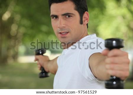 Man lifting weights - stock photo