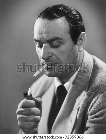 Man lighting a cigarette - stock photo
