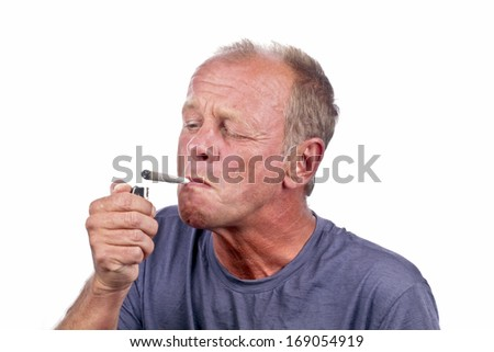 Man lightning a marihuana joint - stock photo