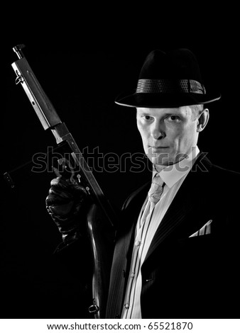 Man like a chicago gangster with submachine gun - stock photo