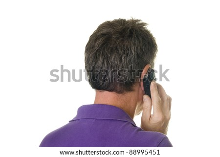 Man listening on cell phone seen on the back - stock photo