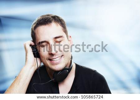 man listening the music in front of abstract background