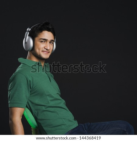 Man listening to headphones - stock photo