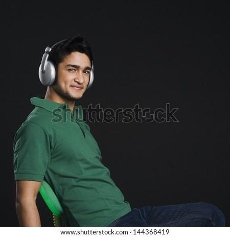 Man listening to headphones - stock photo